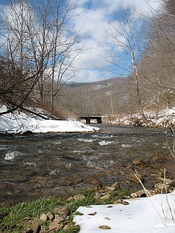 Big Spring Fork as it heads for the Elk River, just beyond the rail bridge.  Gauley Mountain, hoarfrosted, communes with the sky.<br /><i>This would be the discharge vicinity for the sewer plant.</i>