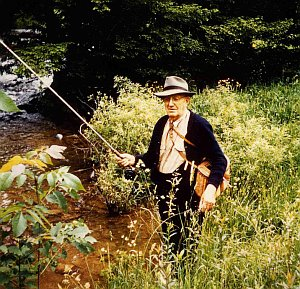 "<a href=""../main/history.php#fifth"">L.D. Sharp</a> fishing Big Spring Fork near its confluence with the Elk (circa 1960)."